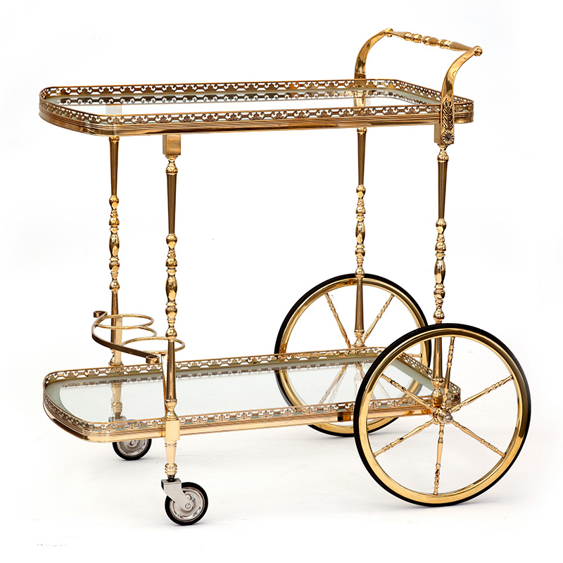 Vintage brass two tier bar cart with integrated bottle holders (Circa 1930).