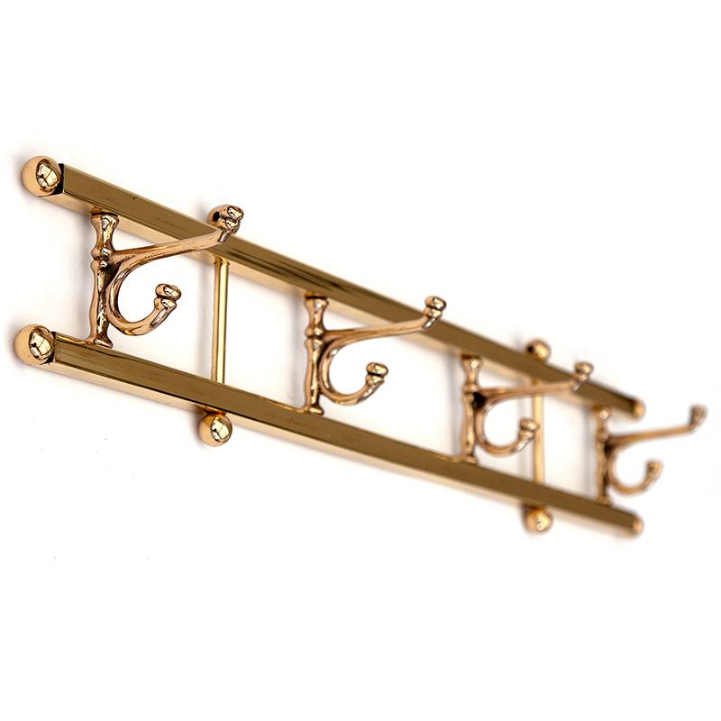 Set of four pivoting brass coat hooks. (c.1930).