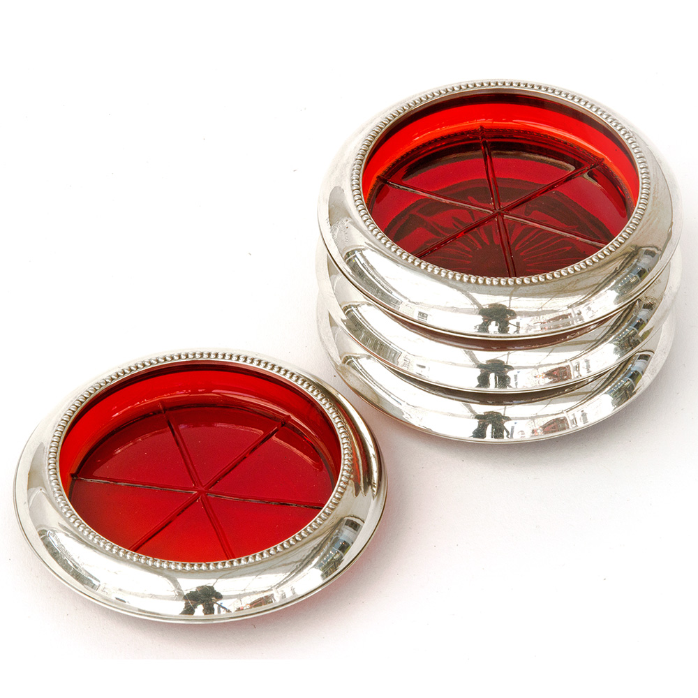 Set of Four mid 20th Century ruby glass coaster with silver plated rims.