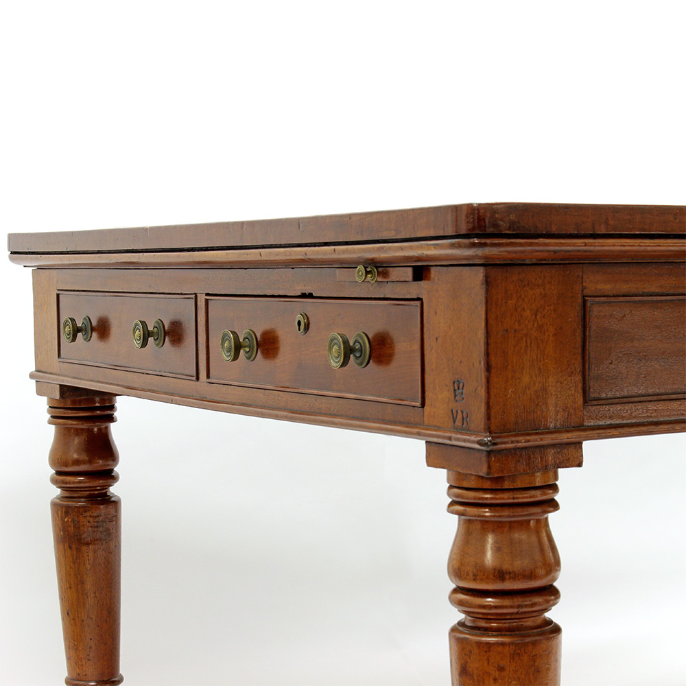 Antique mahogany black leather lined conference writing table. Inpressed royal crest, reputed Royal provenance. Circa 1860.