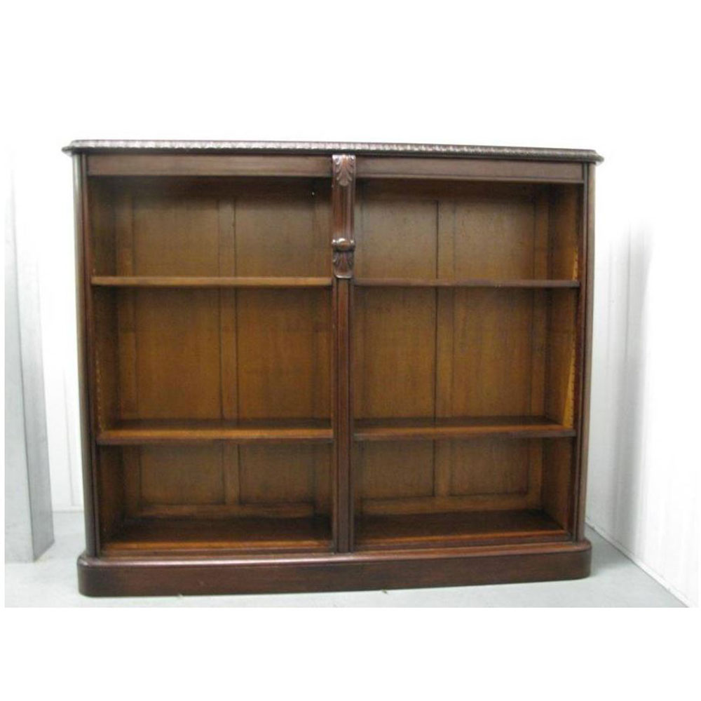 Antique mahogany open book case with adjustable shelves, gadrooned cornice supported by central corbal. (c.1860)