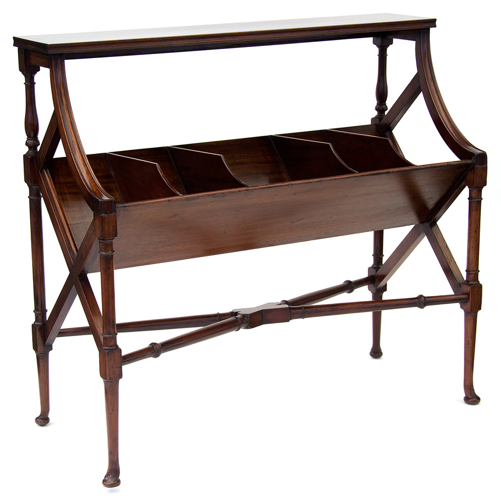 Large antique flame mahogany book trough or book shelf raised on turned cross stretchered supports. (c.1910)
