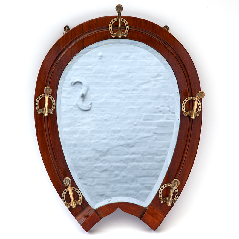 Extremely rare oak deep bevelled horseshoe mirror with cast brass fetlock and horseshoe hooks. (c.1890).