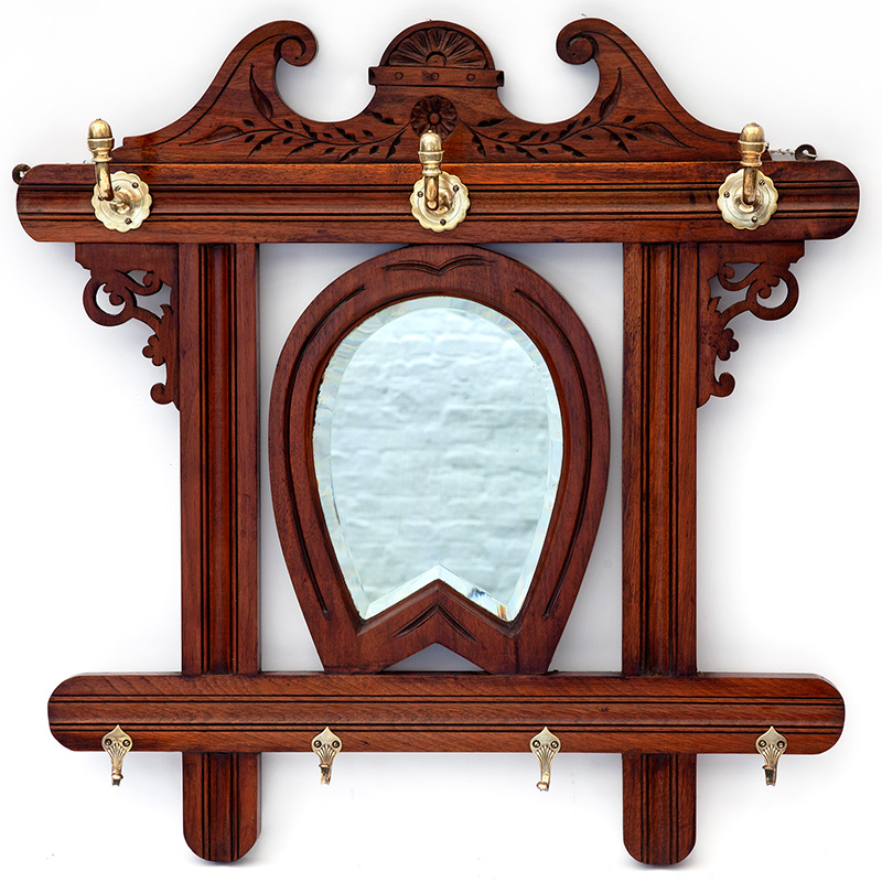 Antique mahogany horseshoe mirror with deep bevelled plate and original brass hooks. (c.1880)