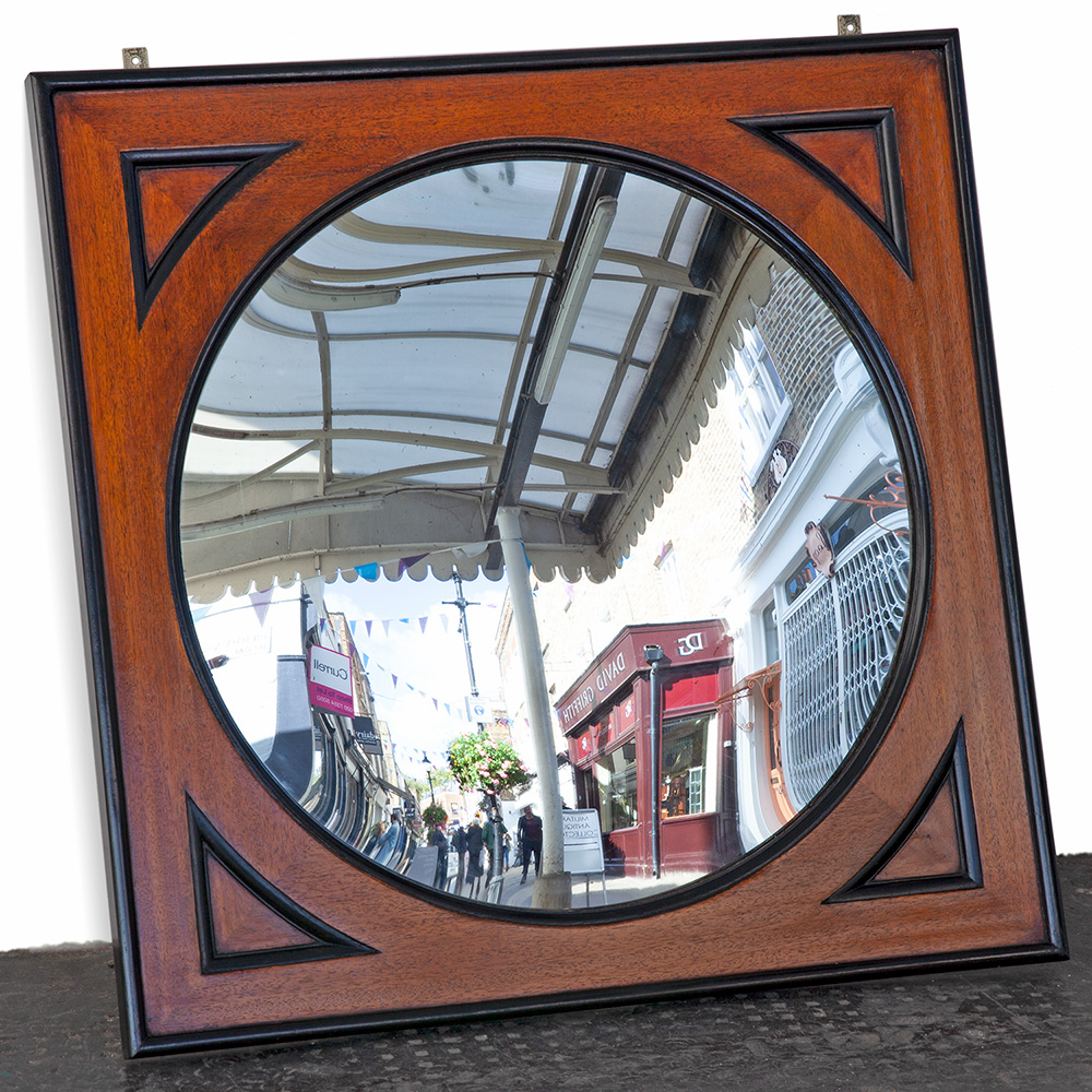 Impressive antique part ebonised late 19th Century mahogany convex mirror in original frame.