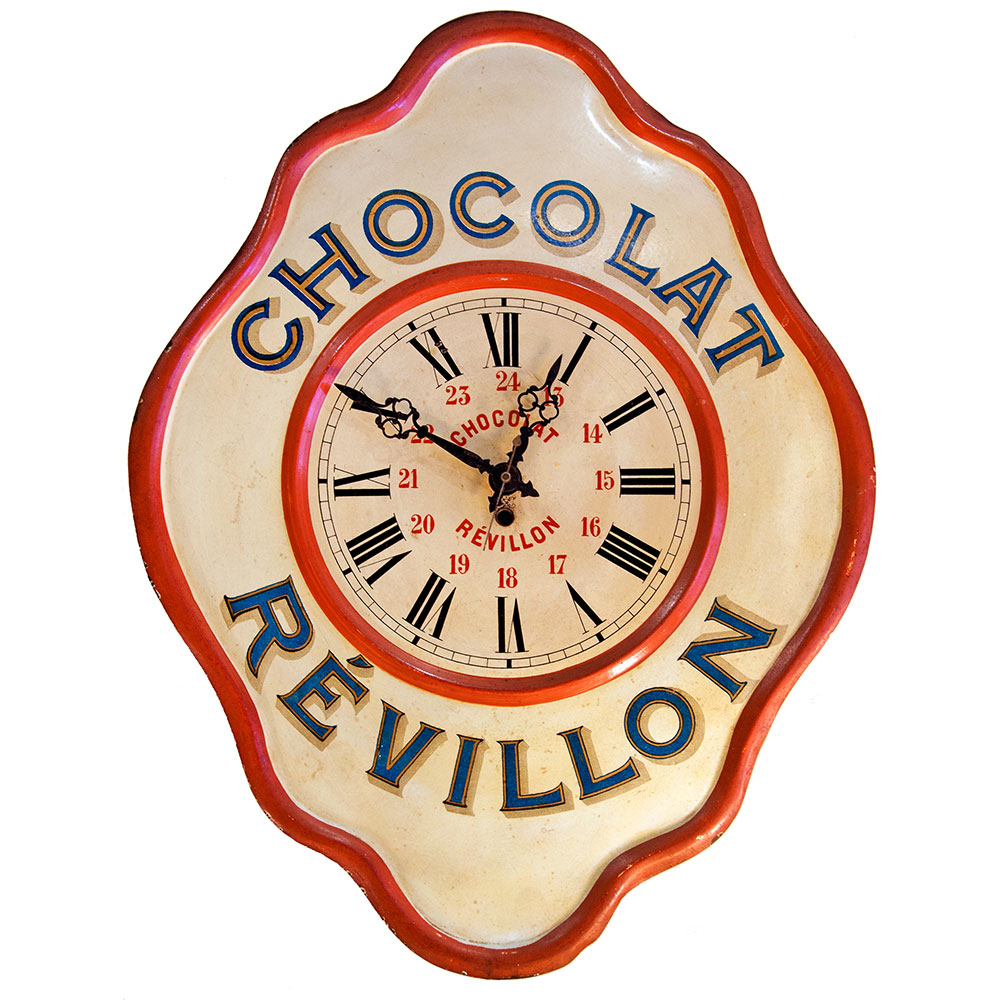 French advertising clock. The wavy border, known as `oeil de boeuf` (bullseye) mimics traditional French wall clocks of the 19th century.