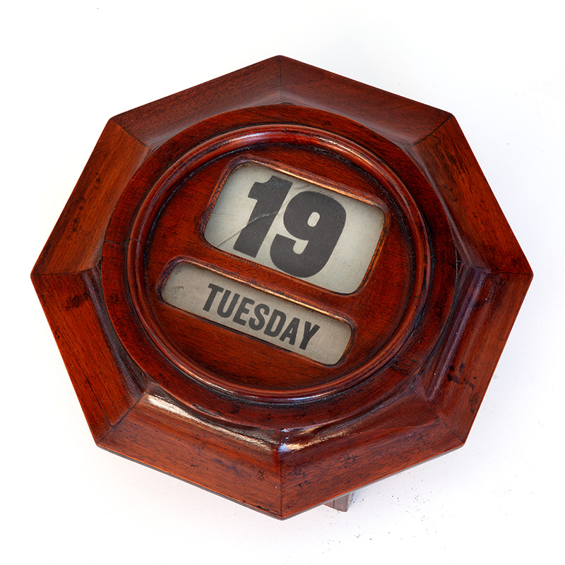 Unusual mahogany octagonal wall mounted day/date perpetual calendar. (c.1900).