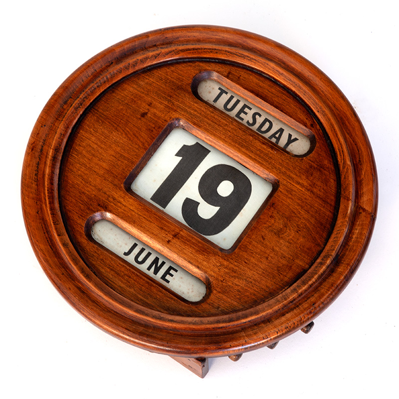 Antique wall mounted round polished mahogany perpetual calendar. (c.1920).