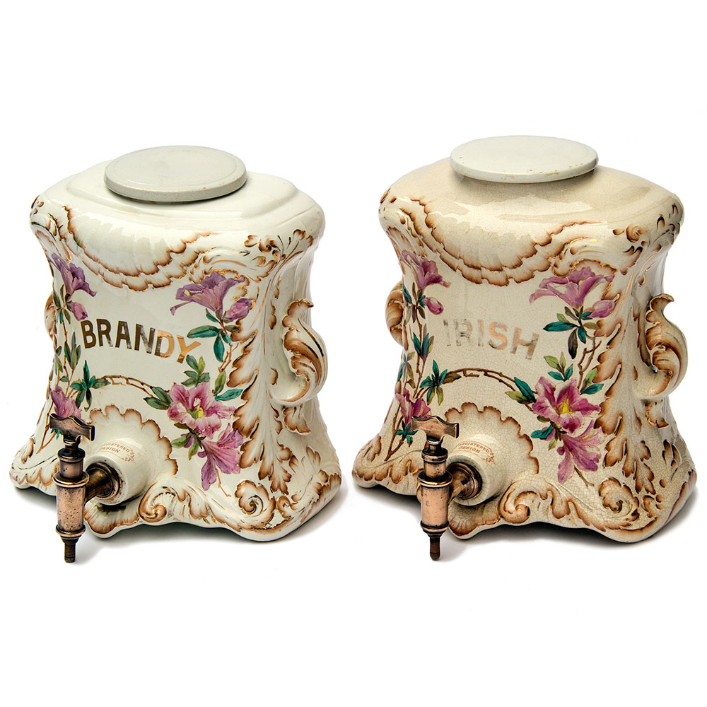 Rare pair of antique serpentine fronted flat back pottery spirit dispensers and lids with original unusual design spigots. Circa 1860.