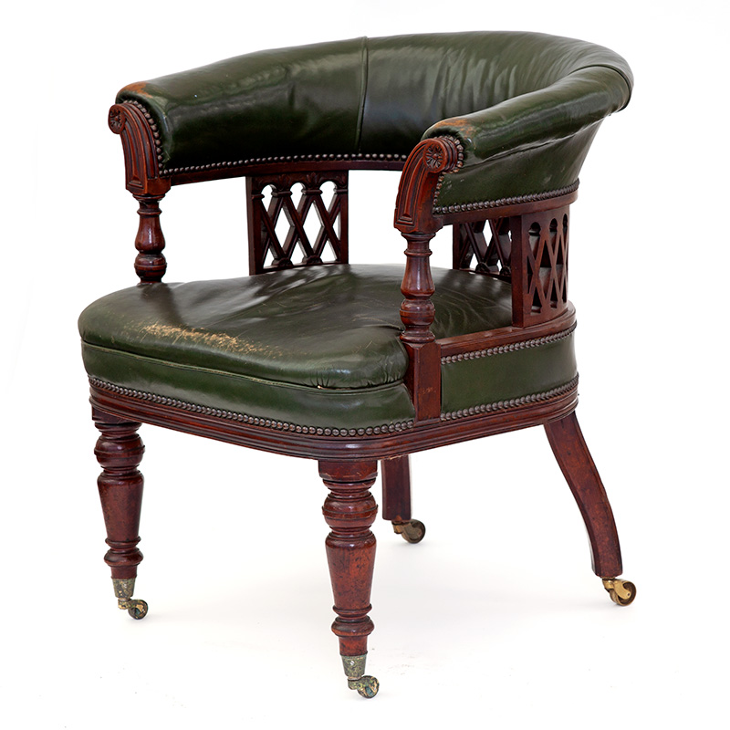 Large and comfortable antique Gentleman's mahogany desk chair with original green leather upholstery. c.1900.