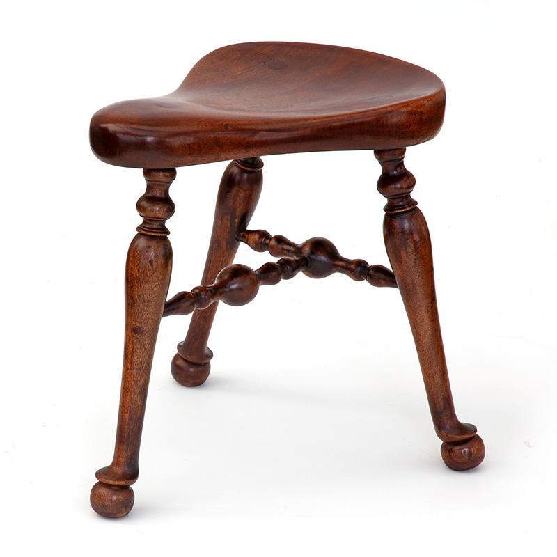 Rare J. Shoolbred (stamped) polished mahogany saddle stool. c.1900.