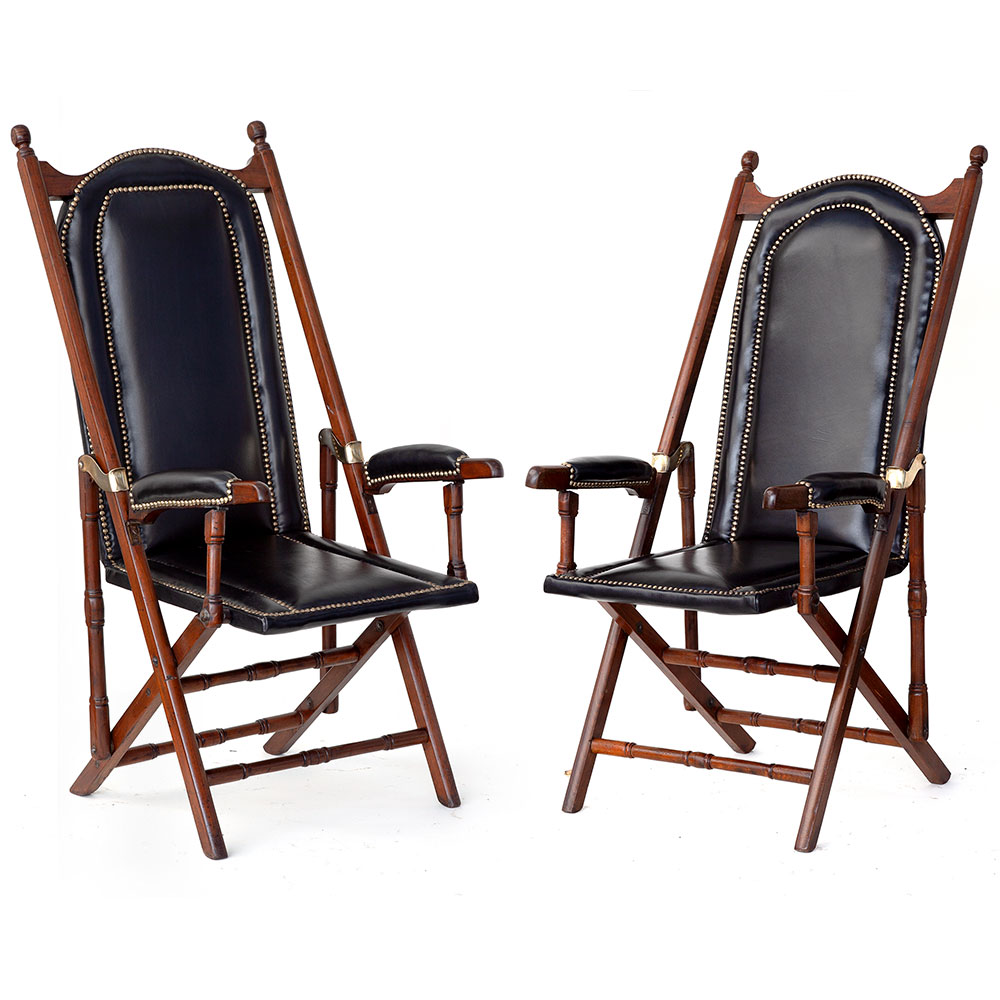 Matched Pair of Folding Teak and Black Leather Steamer Chairs