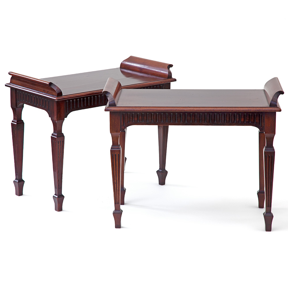 Pair of late Victorian antique polished mahogany wing end window seats with reeded legs and frieze.