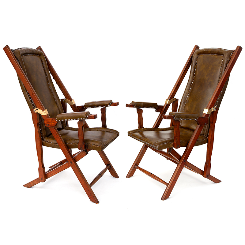 Pair of teak and brass steamer chairs with original leather. Circa 1930.