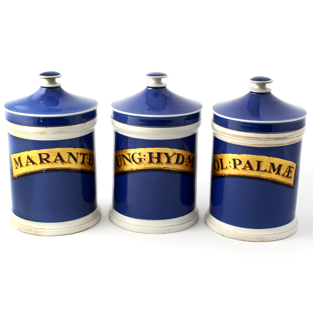 Set of three antique blue and white ceramic apothecary jars with lids. Circa 1870.