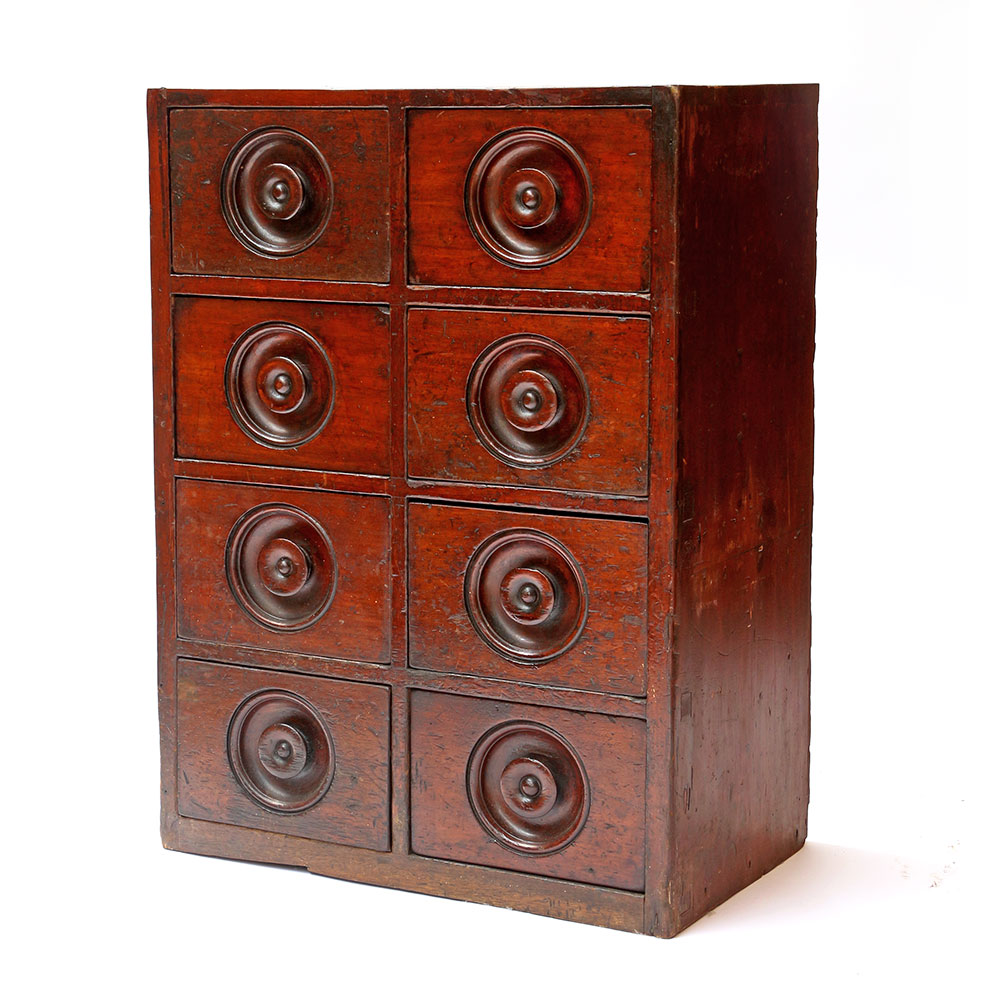 Small set of antique mahogany grocers drawers with inset turned handles. Circa 1880.