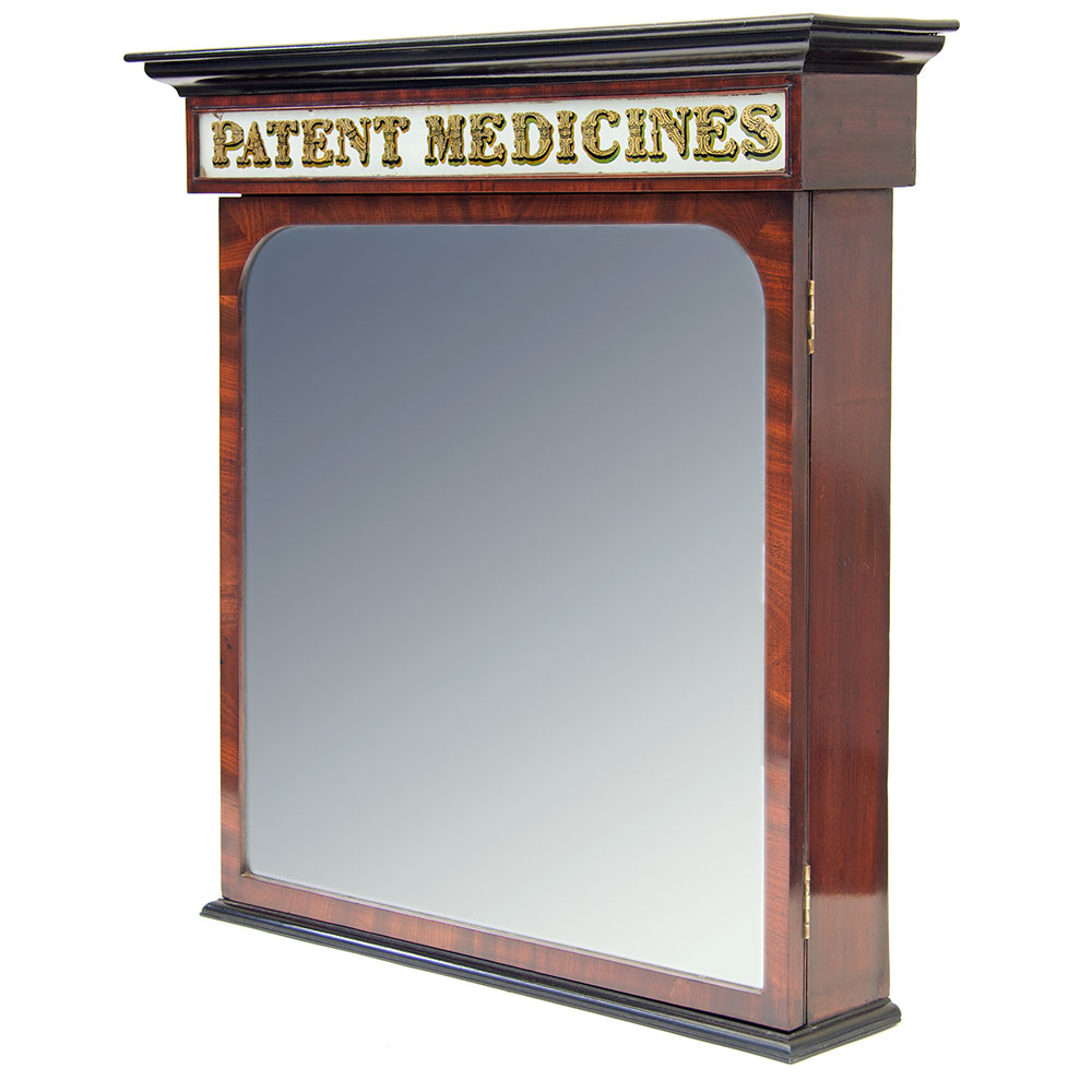 Fantastic antique flame mahogany part ebonised pharmacy `Patent Medicines` cabinet with mirrored door, working lock and original fitted interior. Circa 1850.
