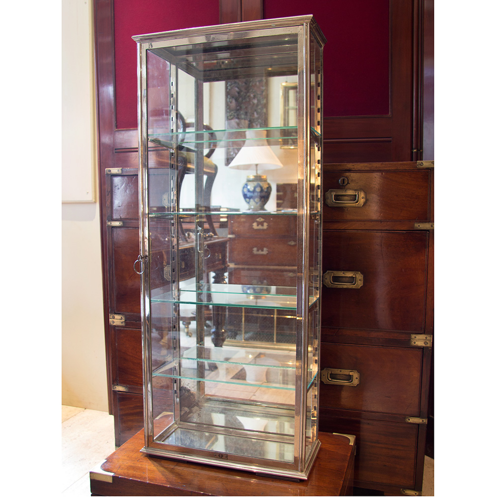 Heavy duty French chrome mirrored display case with four adjustable shelves and original key. Circa 1920.